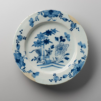 Delftware plate with blue floral and foliate decoration